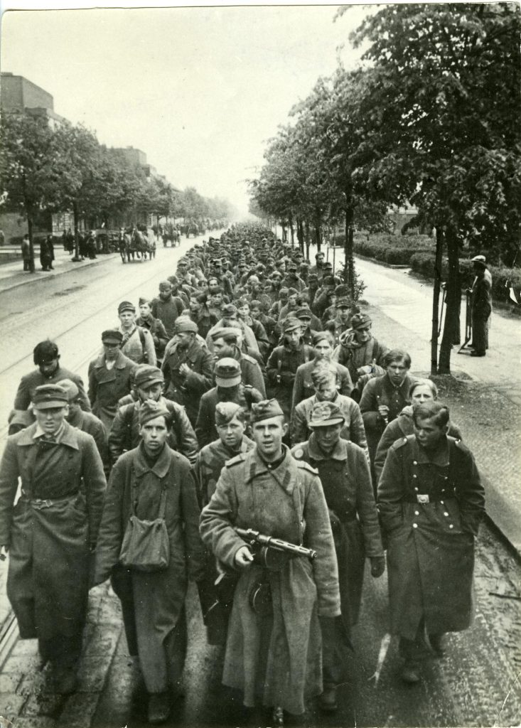 Soldier of the Red Army leads captured Wehrmacht child soldiers through Berlin-Reinickendorf in May 1945 to be transported to a camp as prisoners of war © DHM