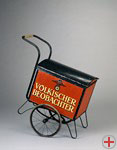 Newspaper cart with the logo of the